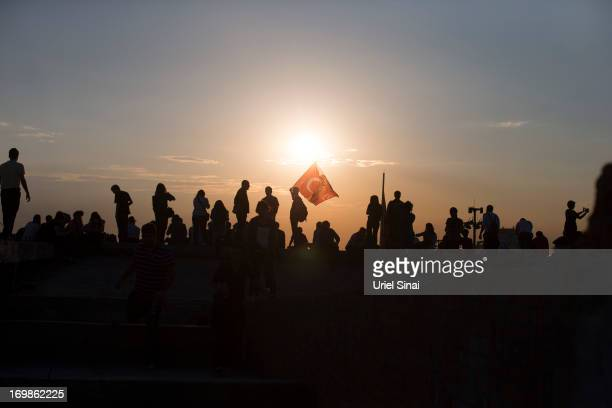 Protestors gather on a roof top at Taksim square on June 3 2013 in Istanbul Turkey The protests began initially over the fate of Taksim Gezi Park one...