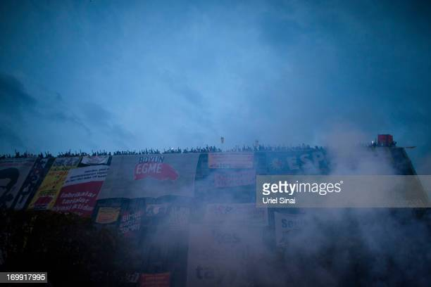 Protestors gather on a roof top in Taksim Square on June 4 2013 in Istanbul Turkey The protests began initially over the fate of Taksim Gezi Park one...