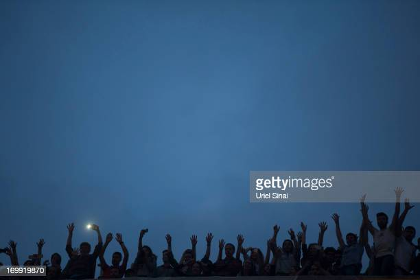 Protestors gather on a rooftop in Taksim Square on June 4 2013 in Istanbul Turkey The protests began initially over the fate of Taksim Gezi Park one...