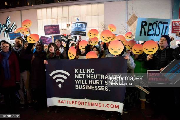 Protestors gather on Bolyston Street in front of a Verizon store during a Net neutrality rally on December 7 2017 in Boston Massachusetts...