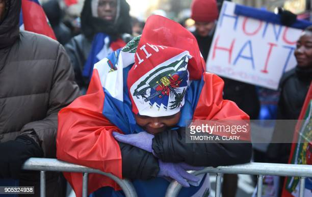Protestors gather on Martin Luther King Jr Day during a demonstration in Times Square called Rally Against Racism Stand Up for Haiti and Africa in...