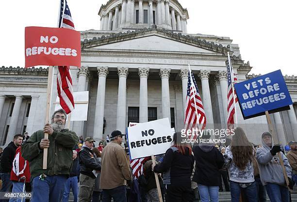 Protestors gather on the steps of the state capitol to protest Gov Jay Inslee's welcoming of all refugees in Olympia Washington on November 20 2015...