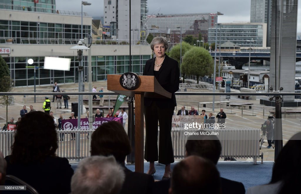 Protestors gather outside as British Prime Minister Theresa May delivers a keynote speech at the Waterfront Hall on July 20, 2018 in Belfast, Northern Ireland. The Prime Minister is on a two-day visit to Northern Ireland. During her visit, focussing on Brexit and the deadlock at Stormont, she will visit the Irish border and discuss the potential impact of Brexit with Northern Irish businesses.