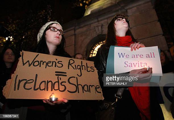 Protestors gather outside Leinster House during a demonstration in favour of abortion legislation in Dublin Ireland on November 14 2012 following the...