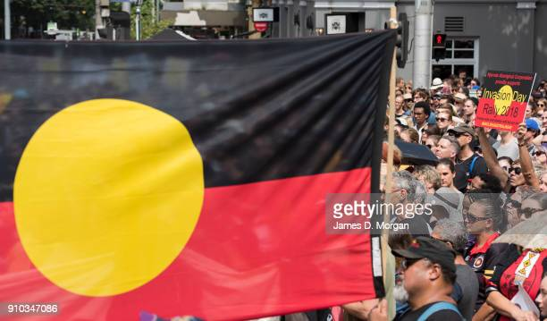 Protestors gather outside State Parliament with aboriginal flags on January 26 2018 in Melbourne Australia Australia Day formerly known as Foundation...