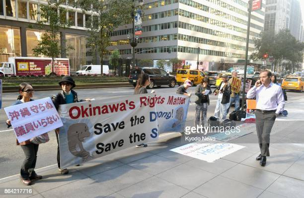 Protestors gather outside the Japanese consulate in New York on Oct 20 calling for a halt to construction of a US military base in Okinawa southern...