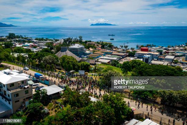 Protestors gather outside the Parliamnet House building during the veteran politician Manasseh Sogavare press conference in Honiara, Solomons Islands...