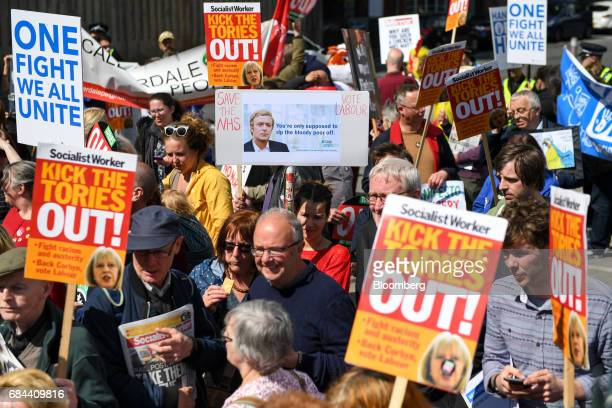 Protestors gather outside the the launch of the Conservative Party's general election manifesto at Dean Clough Mills in Halifax UK on Thursday May 18...