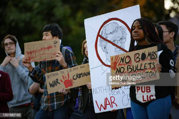 Protestors gather outside the venue where former National Security Advisor John Bolton will discuss the current threats to national security during a...