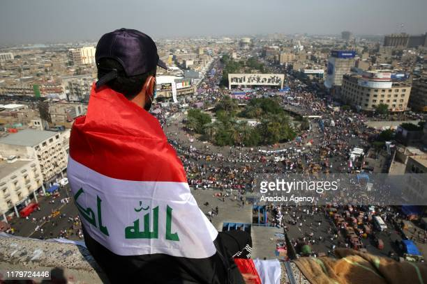 Protestors gather to attend ongoing antigovernment demonstrations economic reforms and overhaul of the political system at Tahrir Square in Baghdad...