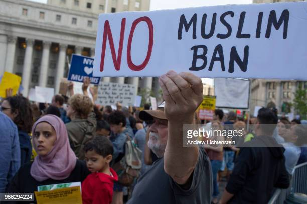 Protestors gather to demonstrate against the Supreme Court's 5-4 decision to uphold President Trump's travel ban against five muslim nations on June...