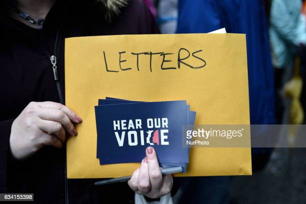 Protestors gathered outside the Center City Philadelphia PA office of State Senator Pat Toomey react as they learn of the tiebreaking vote of...