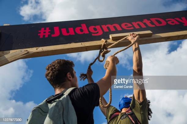 Protestors hang a noose from a handmade gallows during a protest at Martyrs Square on August 9, 2020 in Beirut, Lebanon. Large protests continued for...