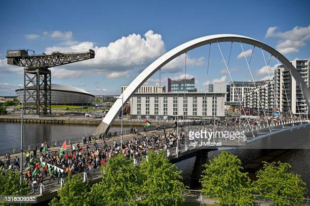 Protestors have gathered in solidarity with the people of Palestine amid ongoing conflict in Gaza on May 16, 2021 in Glasgow, Scotland. The...