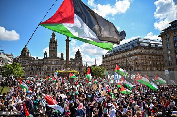 Protestors have gathered in solidarity with the people of Palestine amid ongoing conflict in Gaza, on May 16, 2021 in Glasgow, Scotland. The...