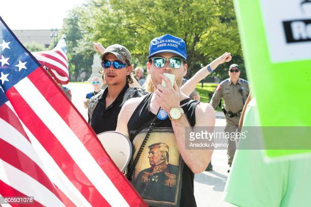 Protestors held a rally at the Texas state Capitol calling for the impeachment of United States President Donald Trump on July 2 2017 A counter...