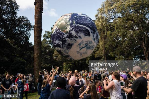 Protestors hit a large globe in the Domain on September 20 2019 in Sydney Australia Rallies held across Australia are part of a global mass day of...