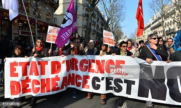 Protestors hold a banner during a demonstration against the state of emergency in France at Place Saint Michel in Paris, on March 12, 2016. The...
