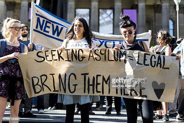 Protestors hold a banner during a protest demanding that asylum seekers held in off shore detention to be brought to Australia at a rally in...
