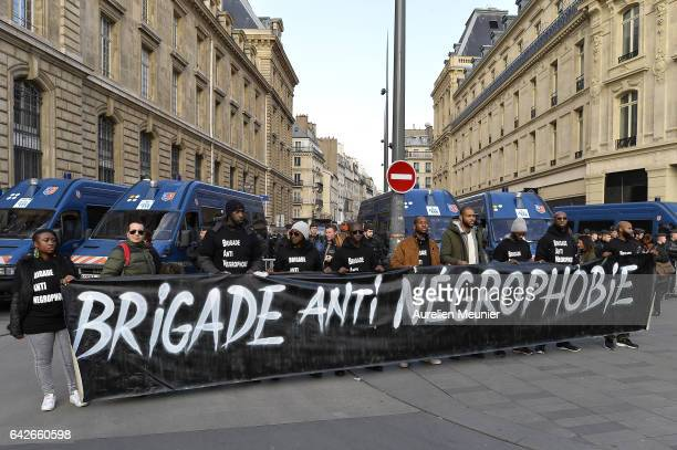 Protestors hold a big antiracism sign in front of the riot police during a antipolice brutality demonstration on February 18 2017 in Paris France...