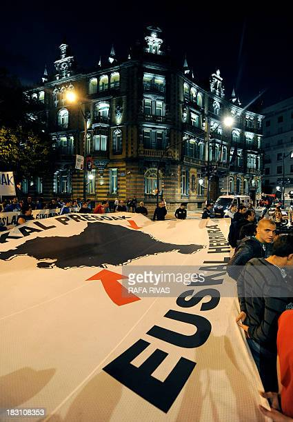 Protestors hold a big banner demanding repatriation for Basque prisoners as they march past the Spanish Government delegation in the Basque Country...