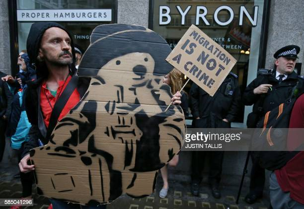 TOPSHOT Protestors hold a demonstration outside a Byron burger restaurant in Holborn central London on August 1 2016 The arrest of dozens of staff...