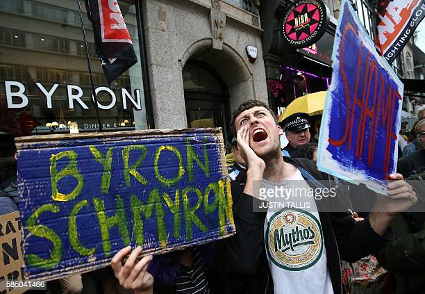 Protestors hold a demonstration outside a Byron burger restaurant in Holborn central London on August 1 2016 The arrest of dozens of staff from the...