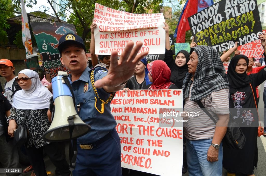 Protestors hold a rally outside the Malaysian embassy in the financial district of Makati on March 5, 2013 in Manila, Philippines. The protestors demand an end to hostilities that have so far claimed the lives of 17 followers of self-proclaimed Sultan of Sulu Jamalul Kiram III and 8 Malaysian security forces in the villages of Lahad Datu and Semporna in Sabah. Around 200 armed followers of Kiram in the restive southern provinces of Sulu and Tawi Tawi in Mindanao crossed over to neighboring Sabah last February 12 to lay claim to territory as ancestral land triggering clashes with Malaysian security forces. Philippine diplomatic officials confirmed Tuesday that security forces in Malaysia have conducted airstrikes and ground assault on the 'royal army'of the Sultanate of Sulu in Lahad Datu, Sabah.