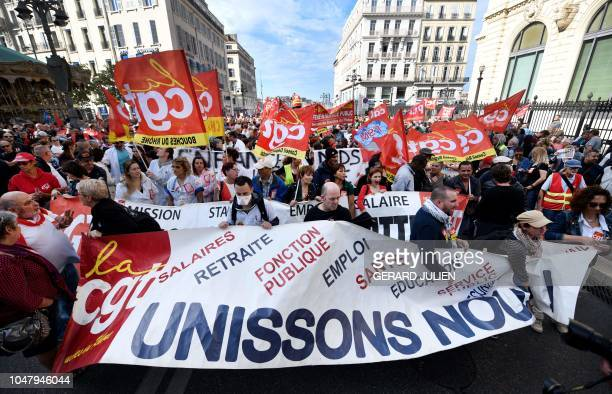 Protestors hold a sign reading Let us unite as they demonstrate on October 9 2018 in Marseille southern France during a oneday nationwide strike over...