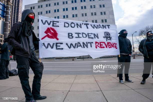 Protestors hold a sign up as members of Antifa march from City Hall to the Ohio Statehouse after President Joe Biden was sworn into office in the...