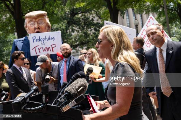 Protestors hold an effigy of former President Donald Trump as Rep. Marjorie Taylor Greene speaks during a news conference outside the U.S. Department...