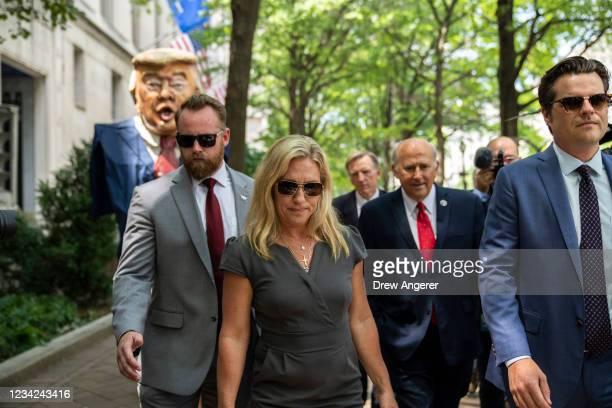 Protestors hold an effigy of former President Donald Trump as Rep. Marjorie Taylor Greene , Rep. Louie Gohmert and Rep. Matt Gaetz arrive for a news...