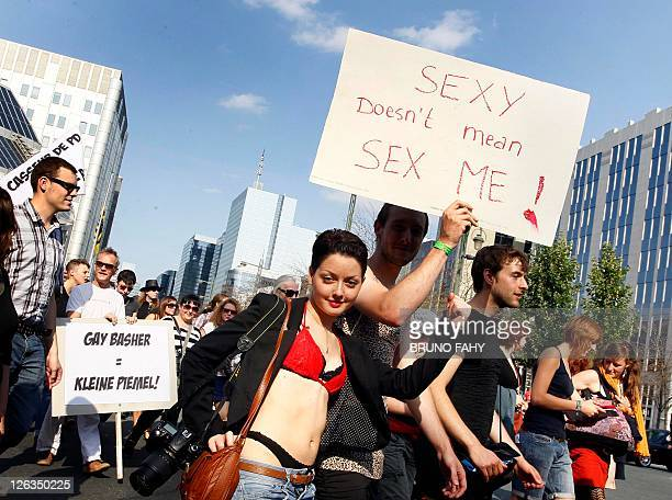 Protestors hold anners during the Slutwalk demonstration in Brussels on 25 September 2011 Slutwalk is an international protest movement against the...