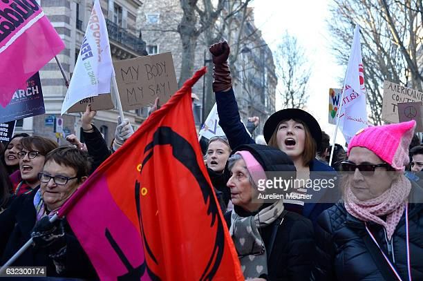 Protestors hold antiTrump signs as over 2000 people protest during the Women's march in front of Trocadero on January 21 2017 in Paris France The...