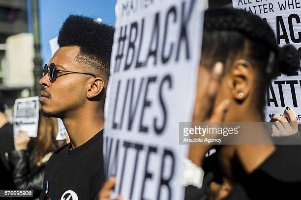 Protestors hold banners and chant slogans during a Black Lives matter rally in Melbourne Australia on July 17 2016 Approximately 3500 protestors...