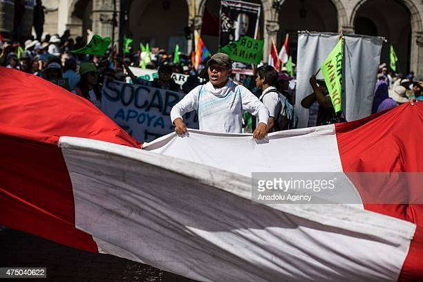 Protestors hold banners and flags during the protest against a 1400 million dollars mining project by Southern Peru in the southern region of Islay...