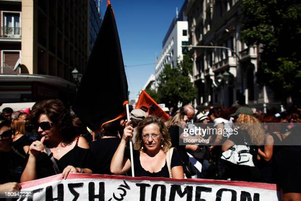Protestors hold banners and prepare to march through the streets during a 48hour strike by Greece's biggest publicsector union ADEDY in central...
