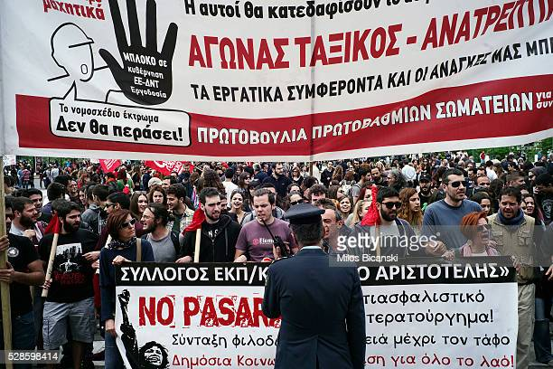Protestors hold banners during a 48hour nationwide general strike on May 6 2016 in Athens Greece Unions called the strike to protest against pension...
