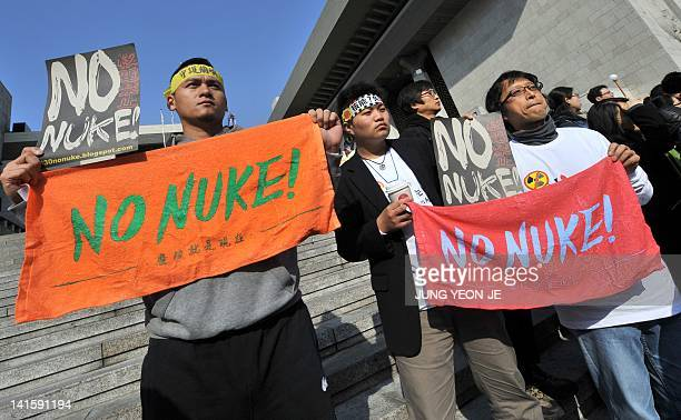 Protestors hold banners during an anti-nuclear rally denouncing upcoming Seoul Nuclear Security Summit in Seoul on March 19, 2012. The campaigners...