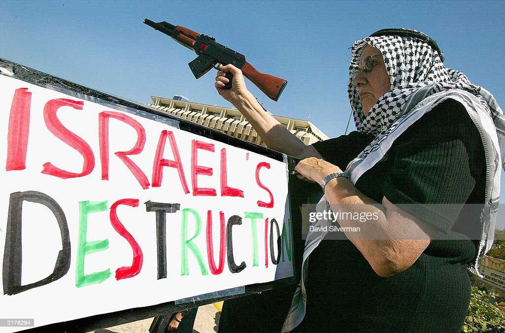 Protestors Hold Banners Outside Ariel Sharon's Headquarters : Stock Photo