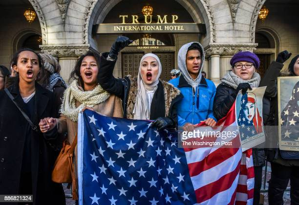 Protestors hold forth in front of Trump International hotel after a rally called 'Peace for Iran' wherein thousands gathered in LaFayette square to...