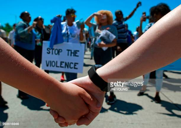 Protestors hold hands along the shutdown Dan Ryan Expressway during an antiviolence demonstration in Chicago July 7 2018 Thousands of protesters...