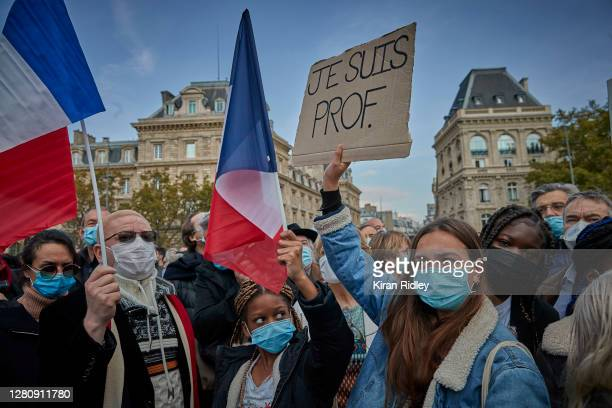 Protestors hold 'Je Suis Prof' placards during an anti-terrorism vigil at Place de La Republique for the death of Samuel Paty who was murdered in a...