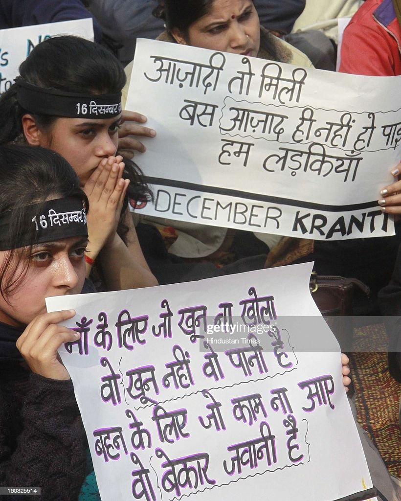 Protestors hold placards and shout slogans demanding the death penalty for six men accused of the fatal gang rape of a young woman last month during protest at Jantar Mantar on January 29, 2013 in New Delhi, India.