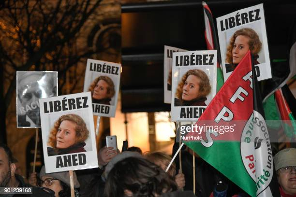 Protestors hold placards bearing the portrait of Palestinian teenager Ahed Tamimi during a demonstration in her support on January 4 in Paris Israel...