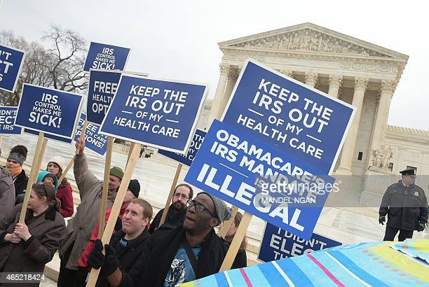 Protestors hold placards challenging 'Obamacare' outside of the US Supreme Court on March 4 2015 in Washington DC The US Supreme Court faces a...