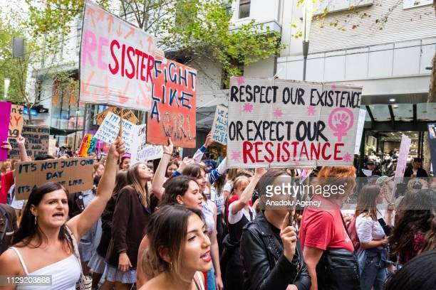 Protestors hold placards during a rally on International Women's Day Rally in the City of Melbourne, Australia on March 08, 2019. Demonstrators...