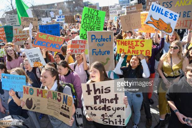 Protestors hold placards during a strike to raise climate change awareness at Cathedral Square on September 27, 2019 in Christchurch, New Zealand....