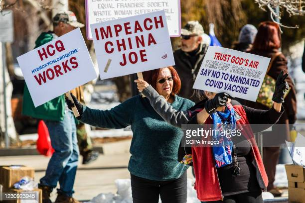 Protestors hold placards during the demonstration. Protesters gathered at the state's legislative building to protest various causes such as the...