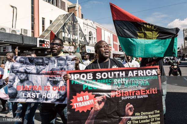 Protestors hold posters and a Biafra flag as they take part in a demonstration in Durban South Africa on May 30 2019 during a Freedom March for...
